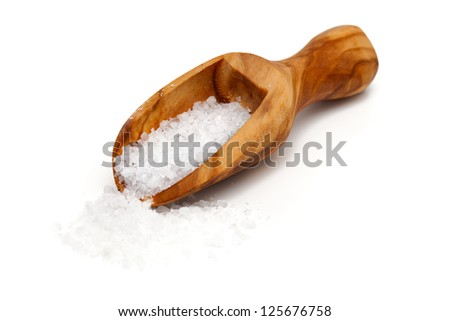 sea salt in a scoop isolated on white background