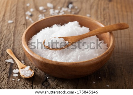 sea salt in wooden bowl and spoon - stock photo
