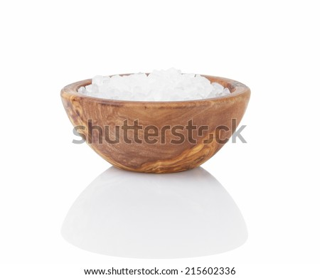 sea salt in wooden bowl for cooking or spa, isolated - stock photo