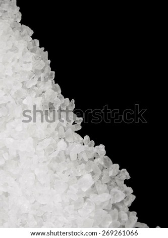 Sea salt isolated on black background
