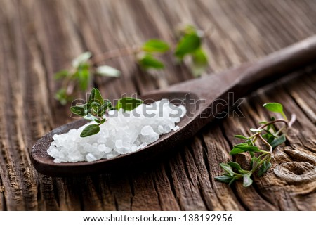sea salt on spoon and thyme - stock photo