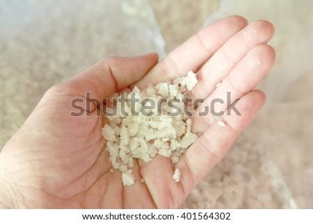 Sea salt on unidentified women hand - stock photo