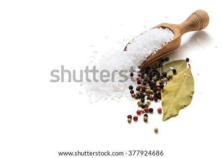 Sea salt, pepper and bay leaf on white background - stock photo
