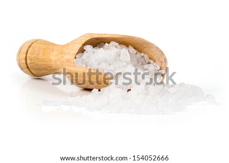 sea salt with a spoon isolated on white background - stock photo