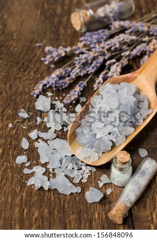 sea salt with lavender on a wooden background - stock photo