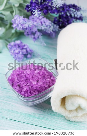 Sea salt with lavender on  wooden background. Selective focus. - stock photo