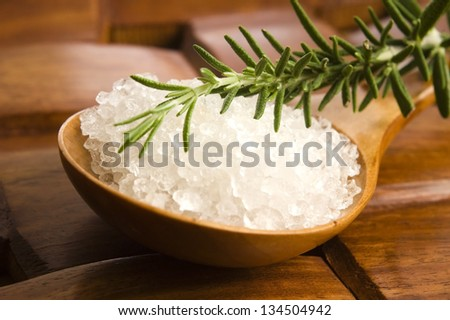 sea salt with rosemary on a wooden spoon