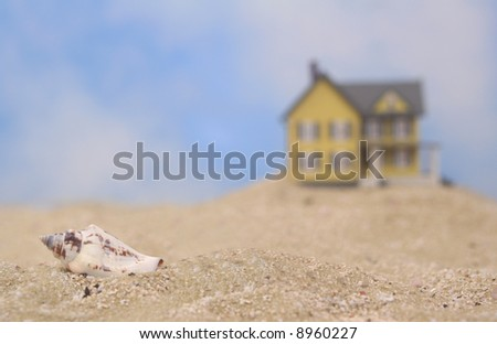 Sea Shell and Beach House, Shallow DOF - stock photo