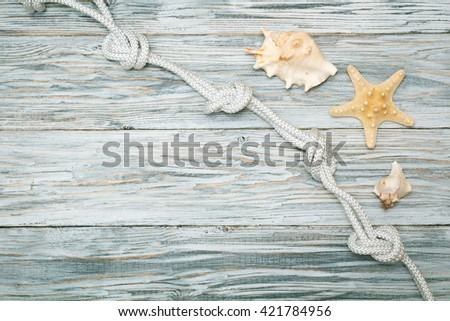 sea shells and rope on old boards, copyspace - stock photo