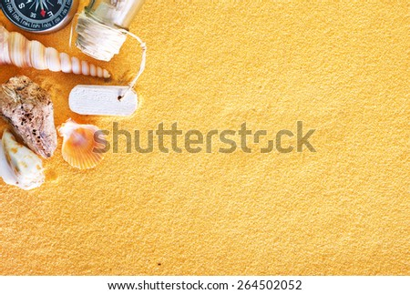sea shells and stones on the yellow sand - stock photo