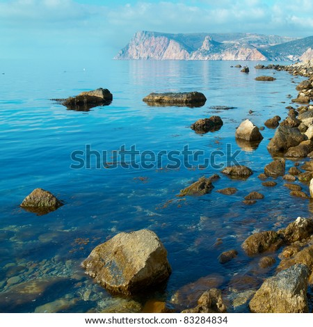 Sea, shore and stones. Seascape at sunset. - stock photo