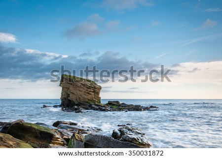 Sea Stack at Collywell Bay / A rocky outcrop and Sea Stack known locally as Charlie's Garden in Collywell Bay, Seaton Sluice on the Northumberland coast - stock photo