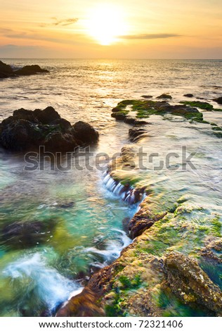 Sea stone and bright sky during sundown. Natural composition - stock photo