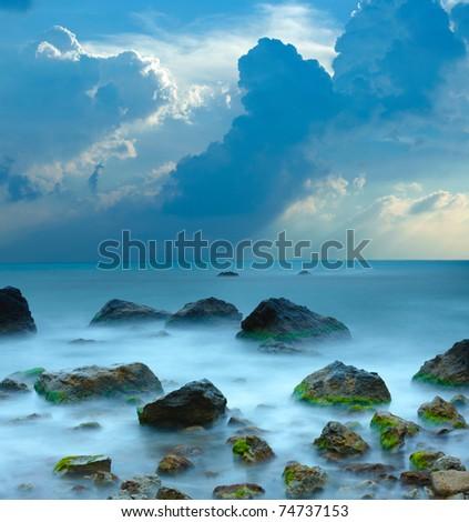 Sea stones at sunset - stock photo