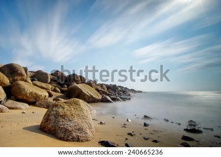 Sea stones at the beach. Long exposure shot. - stock photo