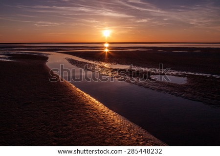 sea, sunset and coastline at Mont Saint Michel, France, Normandy, Europe - stock photo