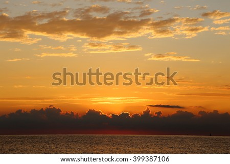 sea sunset with beautiful clouds on the black sea in September