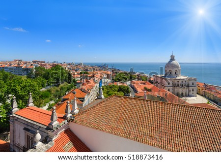 Sea sunshiny view and cityscape from Monastery roof in Lisbon, Portugal.