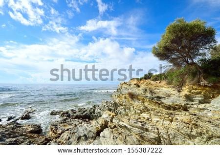 Sea surf on the coast of Sardinia. Italy - stock photo