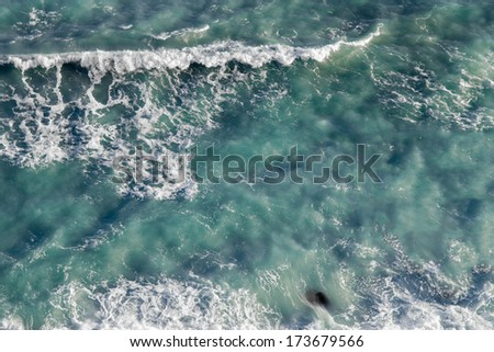 Sea surface covered with foam, abstract background - stock photo