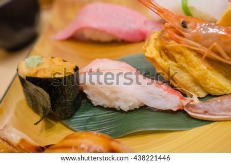 Sea Urchin  sushi (uni) and crab sushi (kani),very delicious and beautiful  japanese seafood sushi set  recipe , good quality and fresh - stock photo