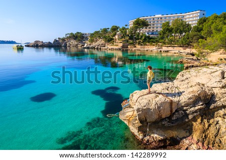 Sea view azure water beach young woman, Cala Fornells, Majorca island, Spain