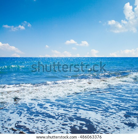 Sea view from tropical beach with sunny blue sky.