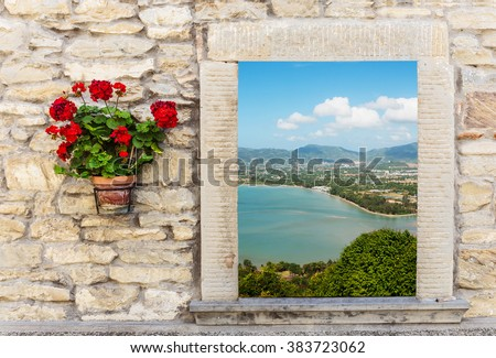 Sea view through the open window with flower in pots - stock photo