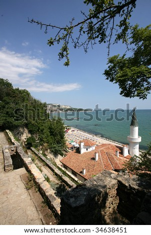 sea view with beach and small castle - stock photo
