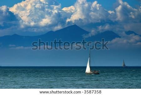 Sea view with white sail yacht - stock photo