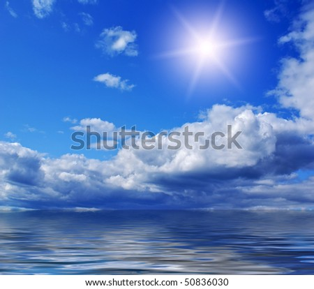 Sea view - wonderful clouds and sun against blue sky - stock photo