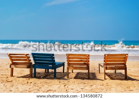 Sea view, wood chairs on the Mirissa beach, Sri Lanka - stock photo