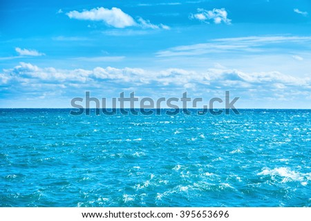 Sea water and blue sky with white clouds. Ocean surface for natural background - stock photo