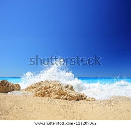 Sea wave on a sandy beach Porto Katsiki in Greece, Lefkada, shot with a tilt and shift lens - stock photo