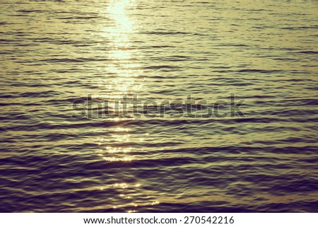 Sea wave with sun flare - vintage filter - stock photo