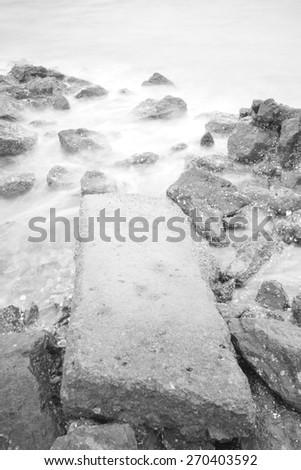 Sea waves and rocks - stock photo