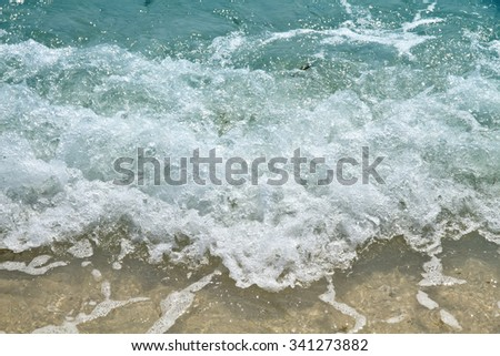 Sea waves and sand beach
