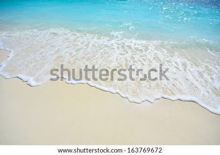 Sea waves and sandy beach  - stock photo
