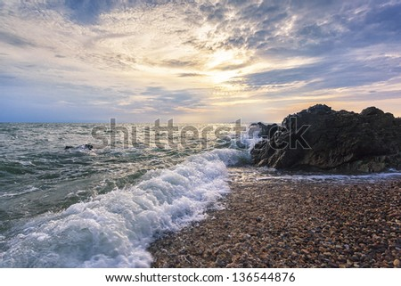 sea waves background beating to the stones - stock photo