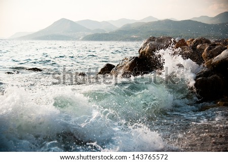 SEA WAVES IN THE ROCKY SHORE - stock photo