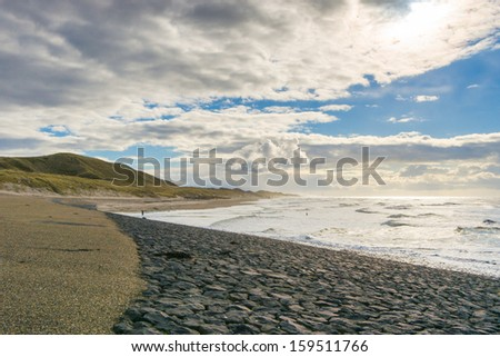 Sea ?waves throw themselves on the rocks of the waterworks of Netherlands - stock photo