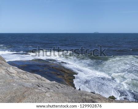 Sea waves washing the rocks - composing with blue sky beautiful landscape - Arpoador - Rio de Janeiro - Brazil - stock photo