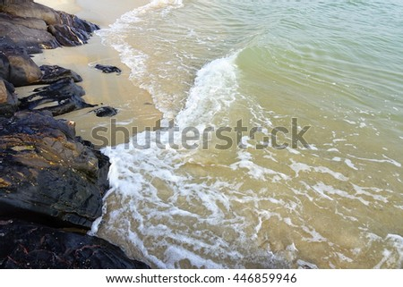 Sea,wet sand,stone,wave at beach southern Thailand on morning time before sunrise,select focus with shallow depth of field:ideal use for background - stock photo