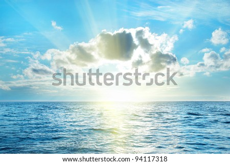 Sea with blue water, sky and clouds. Seascape - stock photo
