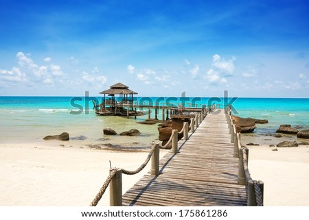 Sea with pier under blue cloudy sky in Koh Kood, Thailand