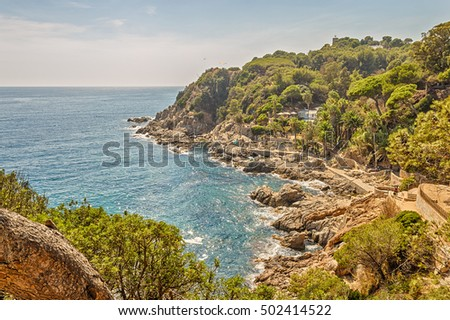 Seacoast in Lloret de Mar with views of the mountain to the castle of San Joan, Costa Brava, Catalonia, Spain.