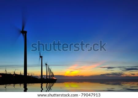 seacoast sunset with street lights - stock photo