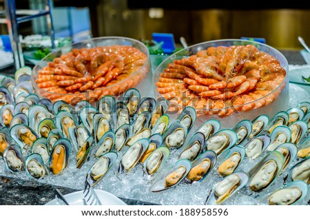 Seafood buffet line (Prawns and New Zealand green mussel) - stock photo
