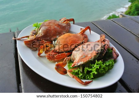 Seafood crabs on white plate