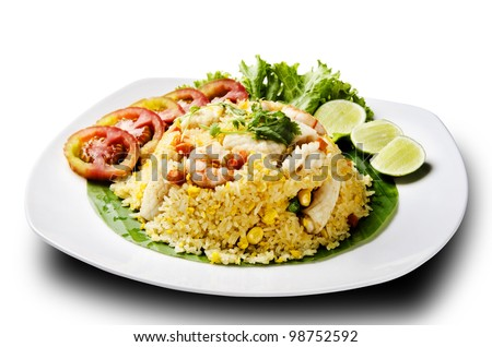 seafood fried rice with tomato and lemon - stock photo